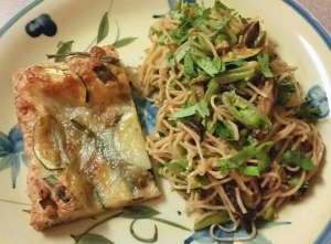 Judy's savory pastry tart using scallions & zucchini topped with cheese; and cold peanut noodles with sliced snap peas, some Thai basil, cilantro (and store bought dried shiitake mushrooms)