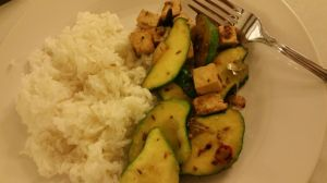 Kohei's pattypan squash, stir fried with garic, freshly ground cayenne peppers, tofu, cumin, and mustard seed.