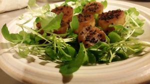 Roasted daikon with black sesame seed on a bed of radish microgreens